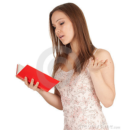 Surprised young woman with red book