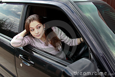 Surprising beautiful woman looking from car