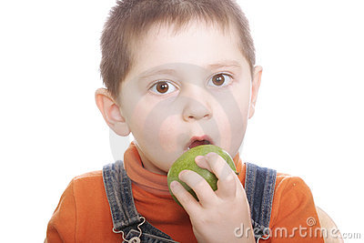 Surprized boy with green apple