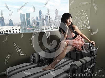 Surreal Girl with abstract wings sitting