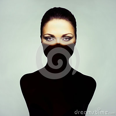 Surrealistic young lady with shadow on her body