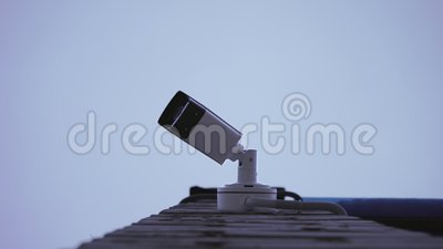 Surveillance camera on the street  Watching people  Equipment, closeup