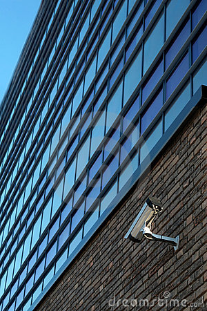 Surveillance camera on wall