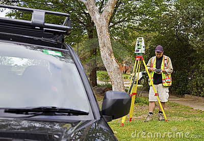 Surveyor checks his work