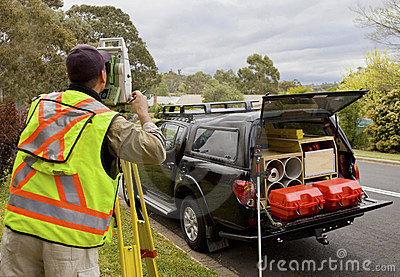 Surveyor checks his work on construction project