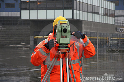 Surveyor measuring land