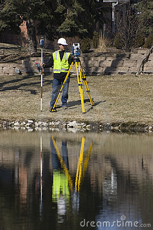 Surveyor working with robotic station