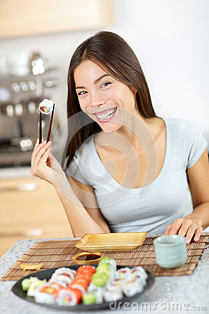Free Sushi Chopstick Holding Young Smiling Asian Female Royalty Free Stock Image - 40734936