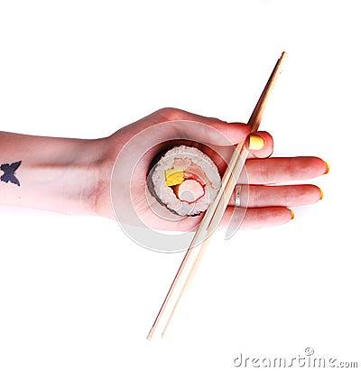Sushi with chopsticks isolated on white