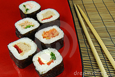 Sushi futomaki with chopsticks