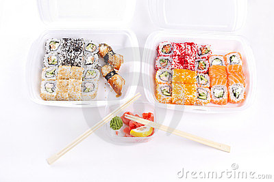Sushi and roll assortment in containers