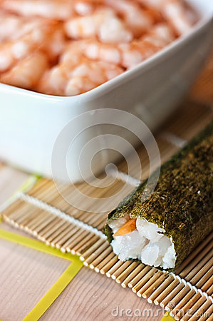 Sushi roll and bowl of shrimp