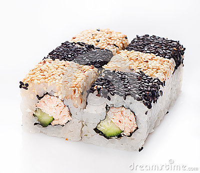 Sushi roll with fish and cucumber in sesame