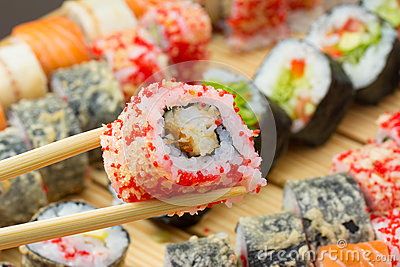 Sushi roll in tempura and red tobiko