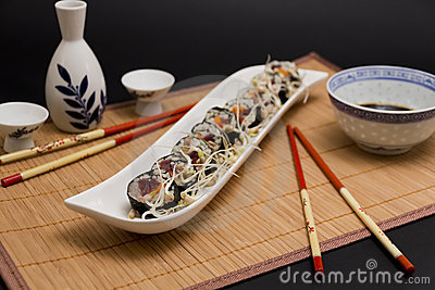 Sushi served with soya sprouts and sake