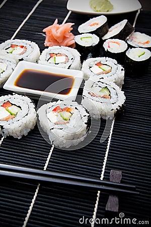 Sushi set on black bamboo mat