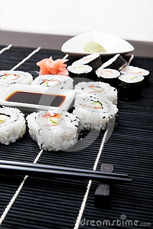 Sushi set on black bamboo mat