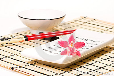 Sushi set and orchid flower on
