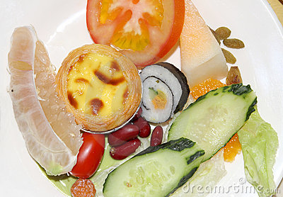Sushi ,tomato,cake and fruit