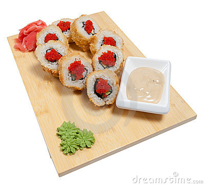 Sushi on wooden stand