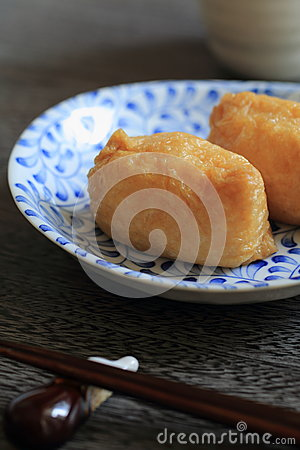 Sushi wrapped in fried bean curd