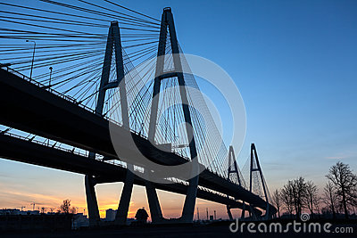 Suspended bridge during sunrise on blue sky