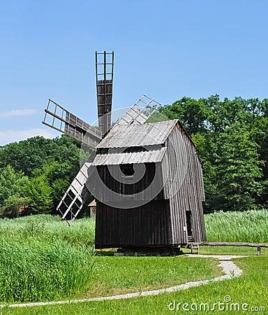 Suspendet windmill near lake