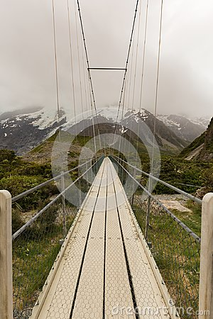 Free Suspension Bridge And Wooden Path In To National Park New Zealand Royalty Free Stock Photo - 114480925