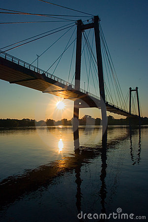 Suspension bridge in sunrise