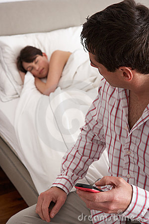 Suspicious Husband Checking Wife s Mobile Phone