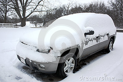 SUV Blanketed with Snow