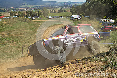 SUV car is passing through difficult terrain skid Editorial Stock Image