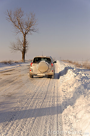 SUV car winter road