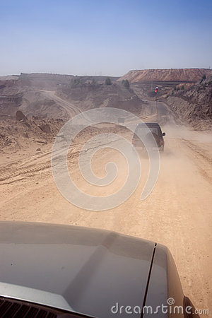 SUV driving off road at mining site