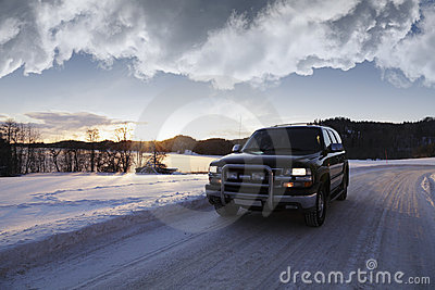Suv, driving through winter scenery