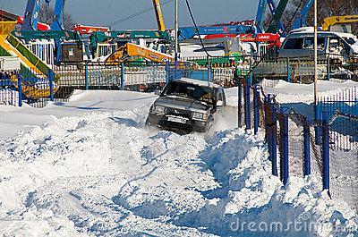 SUV makes its way through the snow Editorial Image