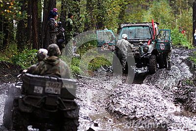 SUV overcomes mud obstacles. Editorial Photo
