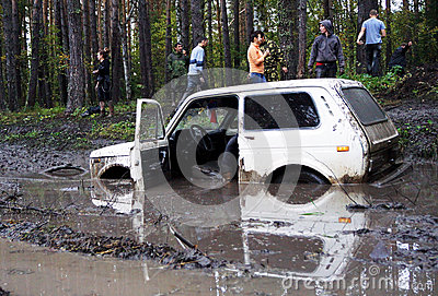 SUV overcomes mud obstacles. Editorial Image