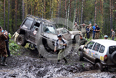 SUV overcomes mud obstacles. Editorial Photography