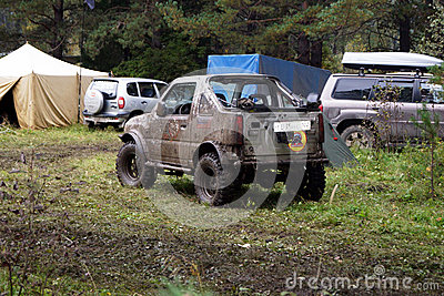 SUV overcomes mud obstacles. Editorial Stock Photo