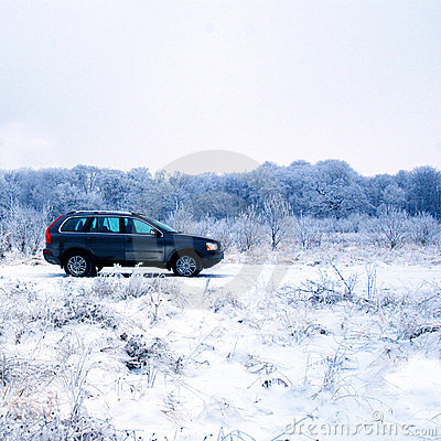 SUV in winter countryside