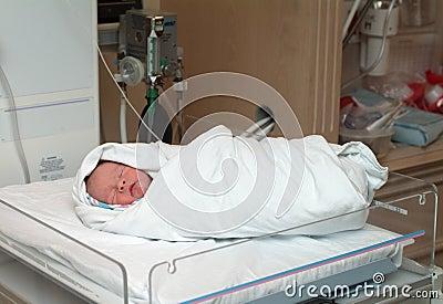 Swaddled newborn in hospital