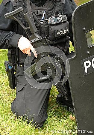 Police SWAT marksman with ballistic shield