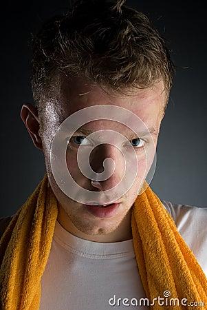 Sweaty sportsman with towel