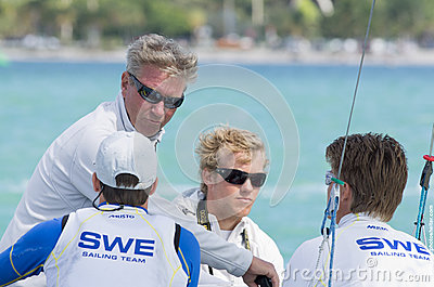 The Swedish coach confers with his 49er sailors at 2013 ISAF Wor Editorial Stock Image