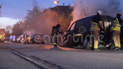 Swedish fire department putting out car fire stock footage