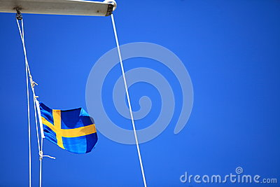 Swedish flag on ship blue sky on background