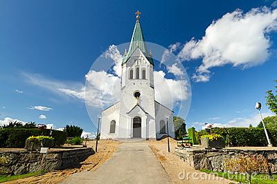 Swedish white church over blue sky