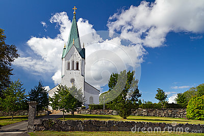 Swedish white church over sunny blue sky