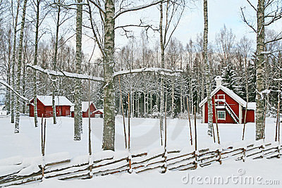 Swedish winter landscape with red wooden houses